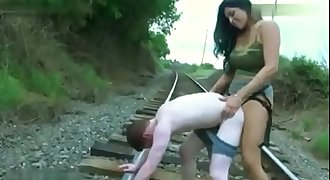 Mean brunette with nice boobs assfucking dude hard on rail tracks